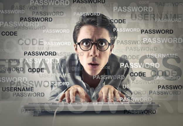 Worried Guy at Computer Thinking about Passwords