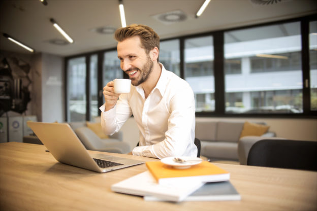 Man at desk with computer enjoying content filtering