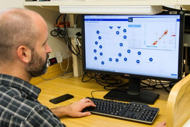 Man looking at computer program thinking it's time to replace their ERP System